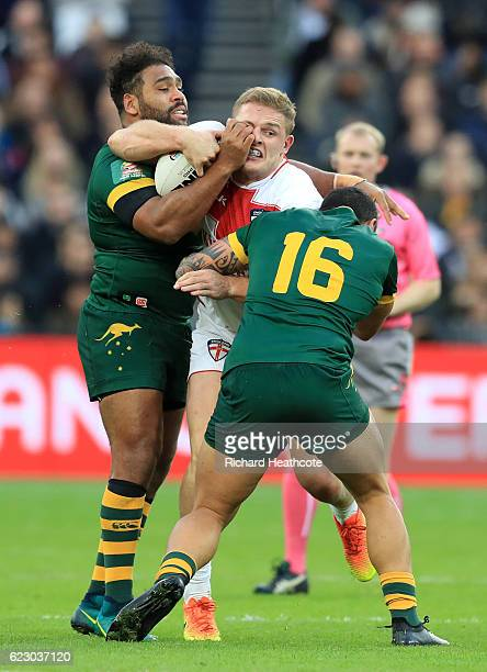 George Burgess of England is tackled by Tyson Frizell and Sam Thaiday of Australia during the Four Nations match between the England and Australian...