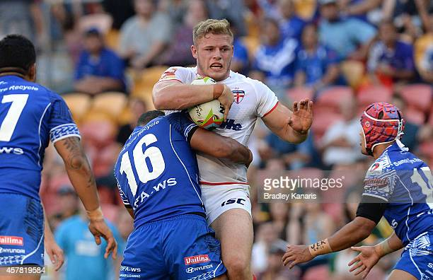 George Burgess of England is tackled during the Four Nations match between England and Samoa at Suncorp Stadium on October 25 2014 in Brisbane...