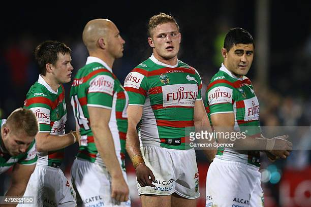 George Burgess of the Rabbitohs and team mates look dejected after losing the round 17 NRL match between the Penrith Panthers and the South Sydney...