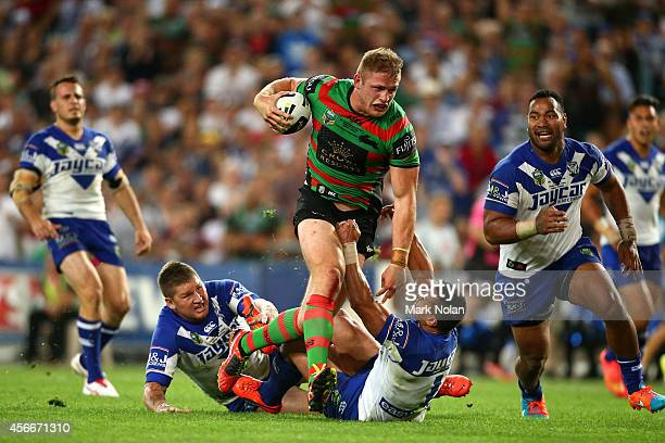 George Burgess of the Rabbitohs breaks a tackle to score a try during the 2014 NRL Grand Final match between the South Sydney Rabbitohs and the...