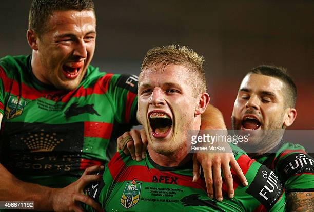 George Burgess of the Rabbitohs celebrates his try with Sam Burgess and Adam Reynolds during the 2014 NRL Grand Final match between the South Sydney...