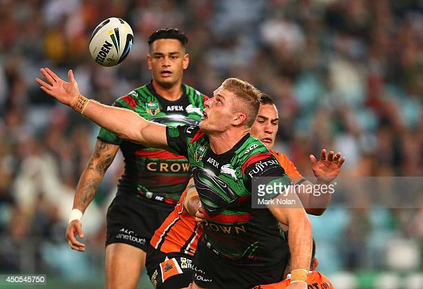 George Burgess of the Rabbitohs fumbles the ball in a tackle during the round 14 NRL match between the South Sydney Rabbitohs and the Wests Tigers at...