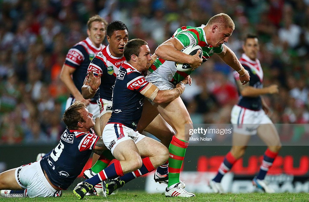 George Burgess of the Rabbitohs heads for the try line to score during the round one NRL match between the Sydney Roosters and the South Sydney Rabbitohs at Allianz Stadium on March 7, 2013 in Sydney, Australia.