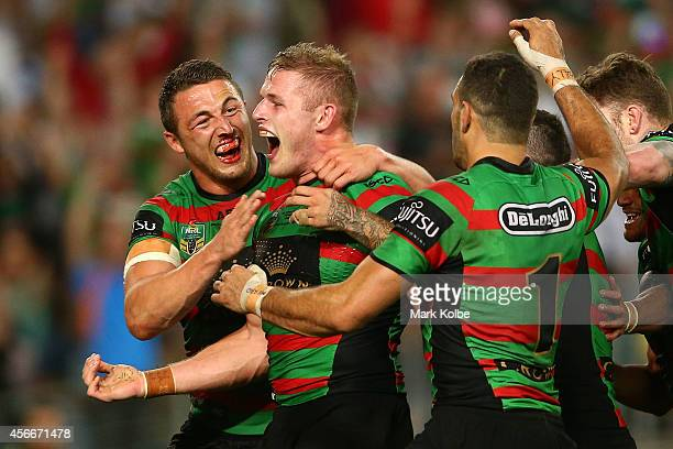 George Burgess of the Rabbitohs is congratulated by his brother Sam Burgess after scoring a try during the 2014 NRL Grand Final match between the...