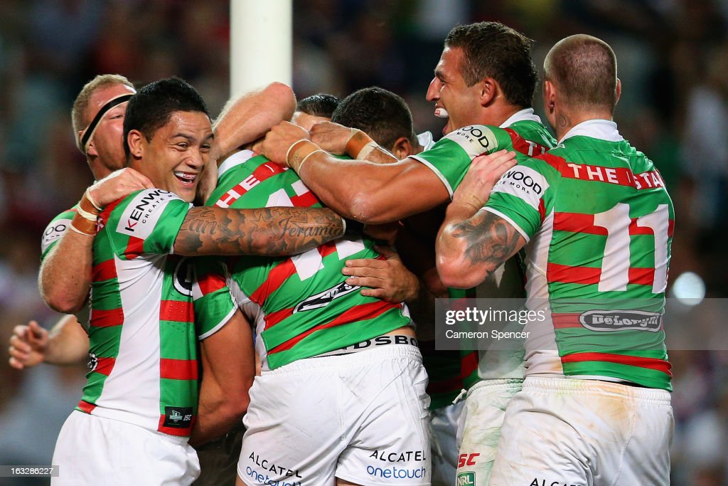 George Burgess of the Rabbitohs is congratulated by team mates after scoring a try during the round one NRL match between the Sydney Roosters and the South Sydney Rabbitohs at Allianz Stadium on March 7, 2013 in Sydney, Australia.