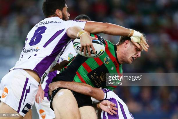 George Burgess of the Rabbitohs is tackled by Jesse Bromwich of the Storm during the round 10 NRL match between the South Sydney Rabbitohs and the...