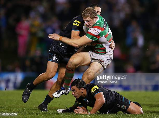 George Burgess of the Rabbitohs is tackled by the Panthers defence during the round 6 NRL match between the Penrith Panthers and the South Sydney...