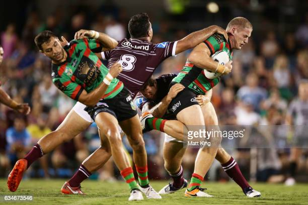 George Burgess of the Rabbitohs is tackled during the NRL trial match between the Manly Sea Eagles and the South Sydney Rabbitohs at Campbelltown...