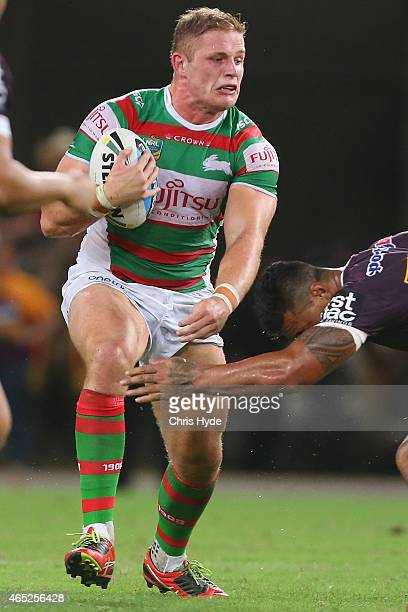George Burgess of the Rabbitohs is tackled during the round one NRL match between the Brisbane Broncos and the South Sydney Rabbitohs at Suncorp...
