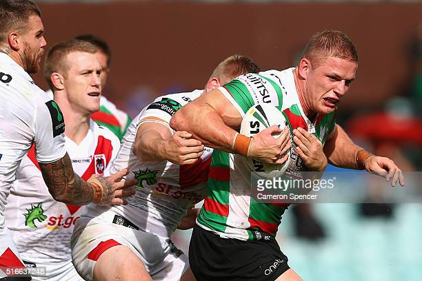 George Burgess of the Rabbitohs is tackled during the round three NRL match between the St George Dragons and the South Sydney Rabbitohs at Sydney...