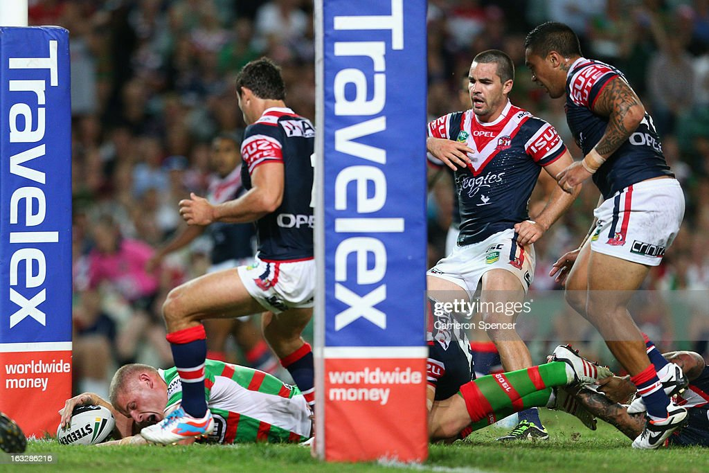 George Burgess of the Rabbitohs scores a try during the round one NRL match between the Sydney Roosters and the South Sydney Rabbitohs at Allianz Stadium on March 7, 2013 in Sydney, Australia.