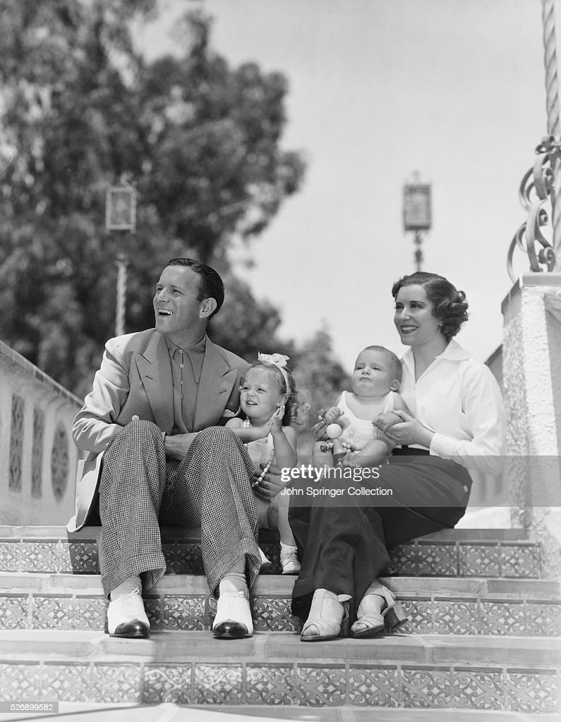 George Burns and Gracie Allen with their two adopted children Sandra age 2 and Ronnie age 9 months