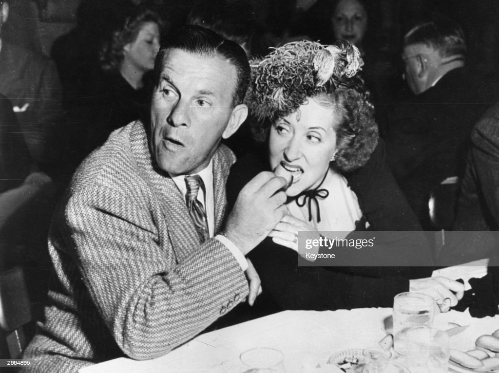 George Burns comedian film actor and radio star feeds his wife Gracie Allen at Hollywood nightspot 'Slapsie Maxies'