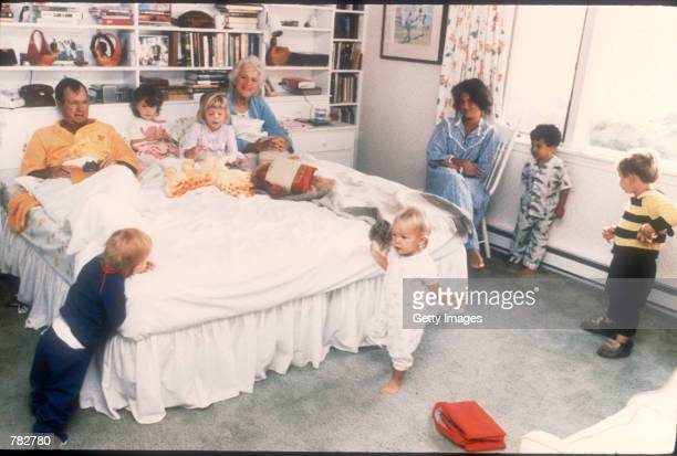 George Bush and his wife Barbara sit in their bed as six of their fourteen grandchildren play around them in Washington DC Bush was born June 12 1924...