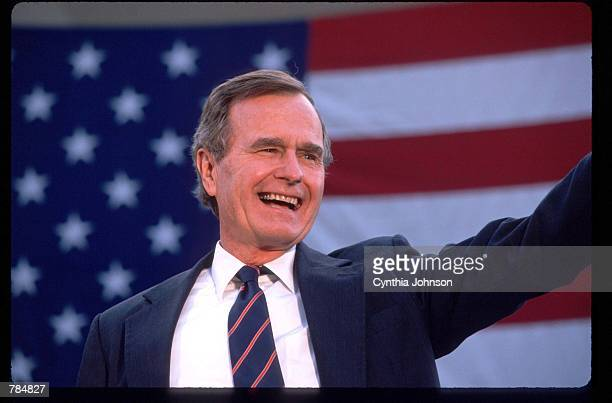 George Bush waves to a crowd of supporters November 5 1988 in the USA Bush and his running mate Dan Quayle defeat Michael Dukakis in the Presidential...