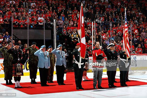 George Canyon and members of the Canadian Military perform the national anthems before puck drop against the Pittsburgh Penguins during an NHL game...