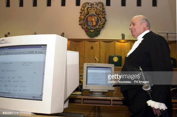 George Cauchi the Secondary and Under Sheriff of the Old Bailey in Court 12 of the Old Bailey London with some of the new technology that is part of...