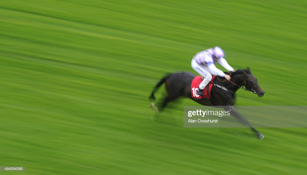 George Chaloner riding Ixelles Diamond win The The Terry Mills Handicap Stakes at Epsom racecourse on August 26, 2014 in Epsom, England.