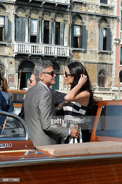George Clooney and Amal Alamuddin arrive in Venice on September 26 2014 in Venice Italy George Clooney is set to marry his lawyer fiancee Amal...