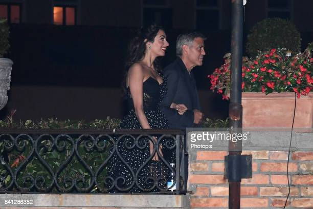 George Clooney and Amal Clooney are seen leaving Hotel Cipriani during the 74th Venice Film Festival on August 31 2017 in Venice Italy