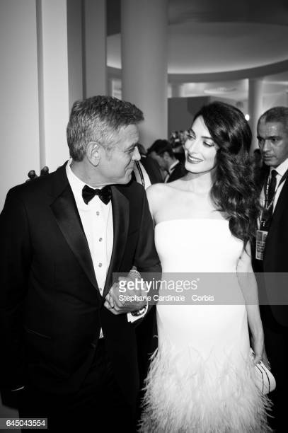 George Clooney and Amal Clooney arrive at the ceremony of the Cesar Film Awards 2017 at Salle Pleyel on February 24 2017 in Paris France