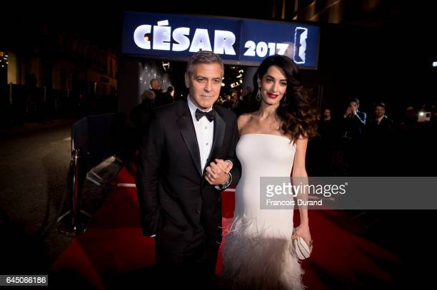 George Clooney and Amal Clooney arrive at the Cesar Film Awards 2017 at Salle Pleyel on February 24 2017 in Paris France