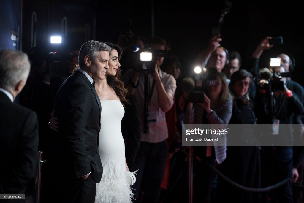 George Clooney and Amal Clooney arrive at the Cesar Film Awards 2017 at Salle Pleyel on February 24, 2017 in Paris, France.