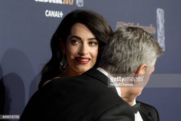 George Clooney and Amal Clooney arrive at the Cesar Film Awards Ceremony at Salle Pleyel on February 24 2017 in Paris France