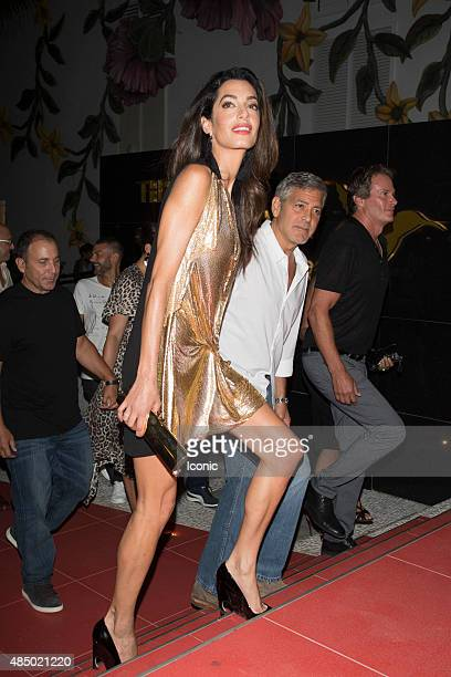 George Clooney and Amal Clooney arrive at the launch of Casamigos Tequila on August 23 2015 in Ibiza Spain
