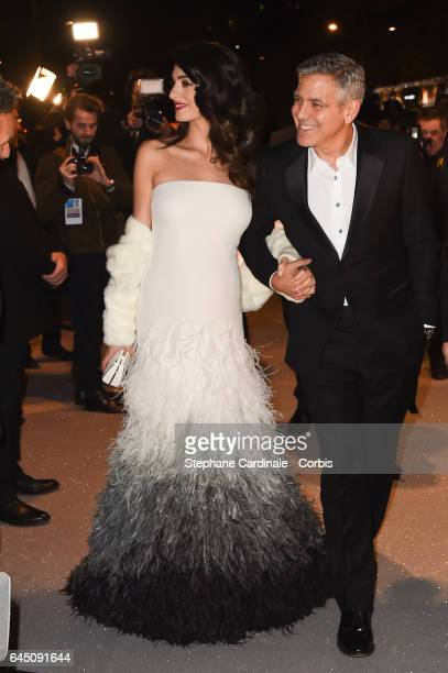 George Clooney and Amal Clooney attend the Cesar Dinner at Le Fouquet's on February 24 2017 in Paris France