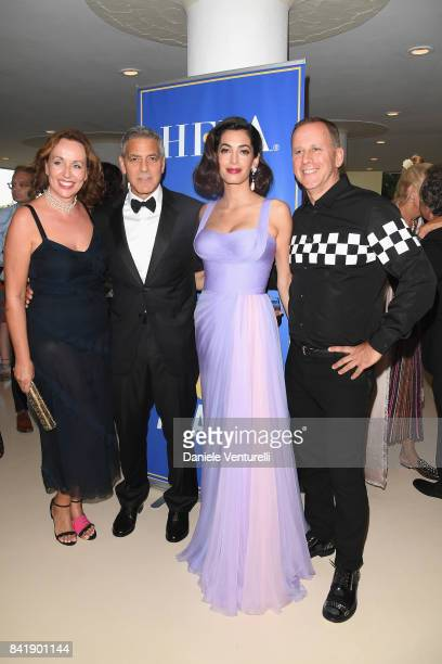 George Clooney and Amal Clooney attend the 'Hollywood Foreign Press Association Cocktail Party' during the 74th Venice Film Festival on September 2...