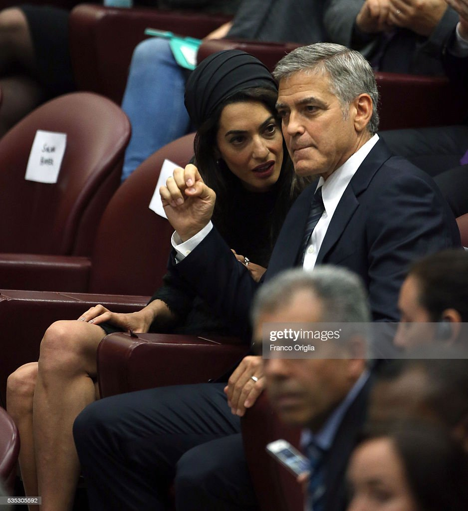 <a gi-track='captionPersonalityLinkClicked' href=/galleries/search?phrase=George+Clooney&family=editorial&specificpeople=202529 ng-click='$event.stopPropagation()'>George Clooney</a> and Amal Clooney attend 'Un Muro o Un Ponte' Seminary held by Pope Francis at the Paul VI Hall on May 29, 2016 in Vatican City, Vatican.