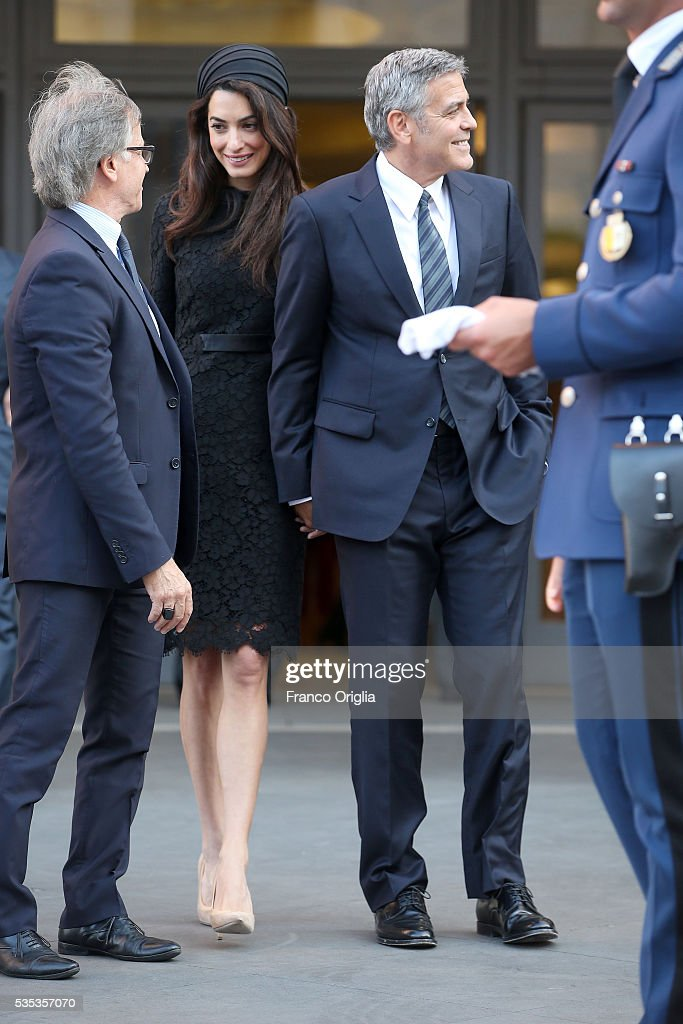 <a gi-track='captionPersonalityLinkClicked' href=/galleries/search?phrase=George+Clooney&family=editorial&specificpeople=202529 ng-click='$event.stopPropagation()'>George Clooney</a> and Amal Clooney leave at the end of 'Un Muro o Un Ponte' Seminary held by Pope Francis at the Paul VI Hall on May 29, 2016 in Vatican City, Vatican.