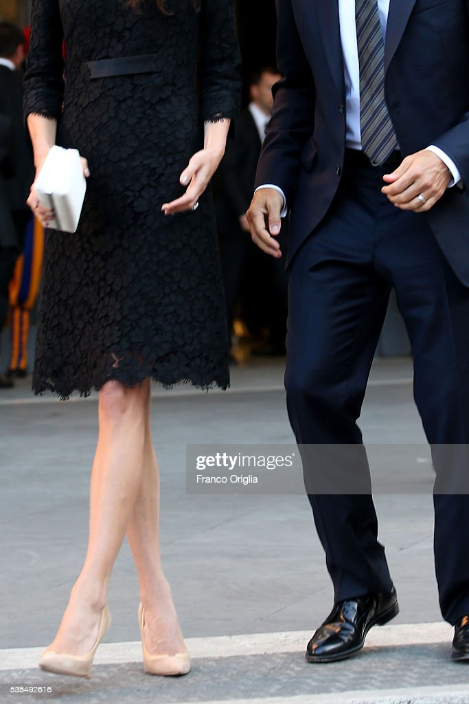 George Clooney and Amal Clooney (bag and shoes detail) leave at the end of 'Un Muro o Un Ponte' Seminary held by Pope Francis at the Paul VI Hall on May 29, 2016 in Vatican City, Vatican.