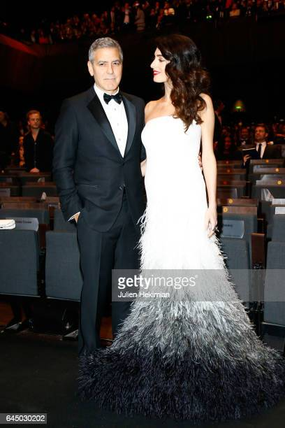 George Clooney and Amal Clooney pose during the Cesar Film Awards Ceremony at Salle Pleyel on February 24 2017 in Paris France