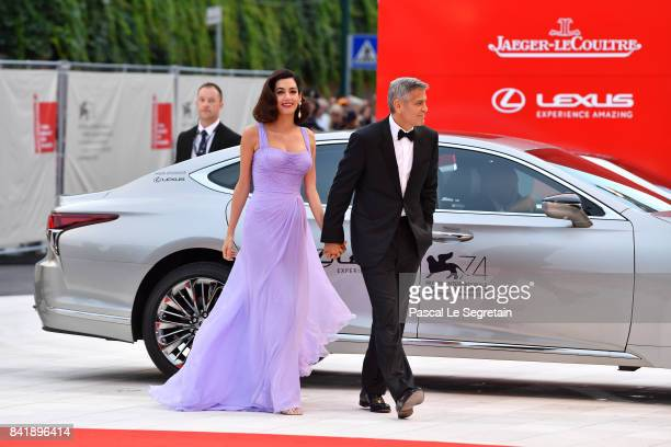 George Clooney and Amal Clooney walk the red carpet ahead of the 'Suburbicon' screening during the 74th Venice Film Festival at Sala Grande on...