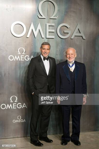 George Clooney and Buzz Aldrin attend the Lost In Space event to celebrate the 60th anniversary of the OMEGA Speedmaster which has been worn by every...