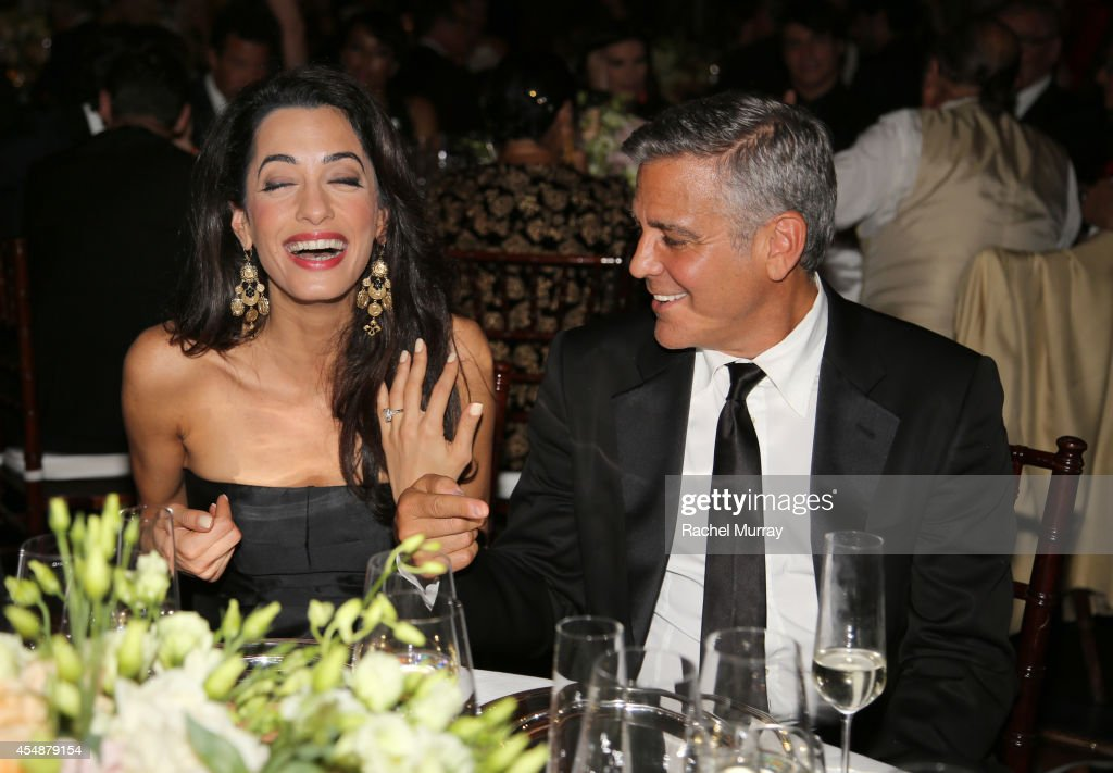George Clooney and fiance Amal Alamuddin attend the Celebrity Fight Night gala celebrating Celebrity Fight Night In Italy benefitting The Andrea...