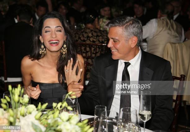 George Clooney and fiance Amal Alamuddin attend the Celebrity Fight Night gala celebrating Celebrity Fight Night In Italy benefitting The Andrea...