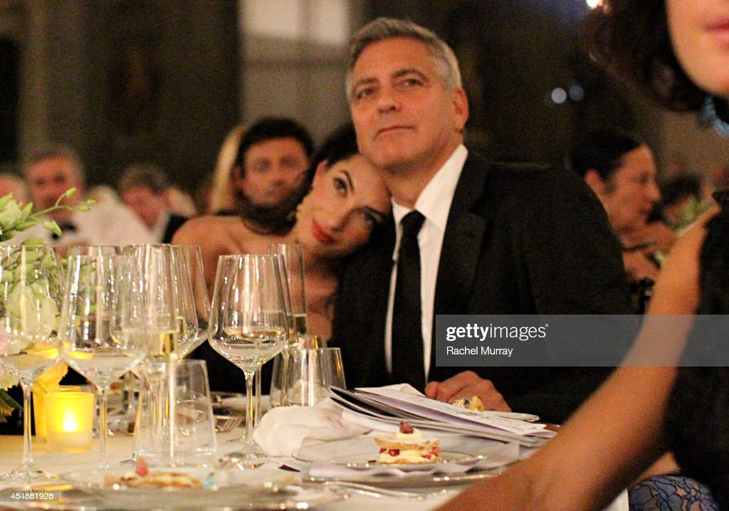 <a gi-track='captionPersonalityLinkClicked' href=/galleries/search?phrase=George+Clooney&family=editorial&specificpeople=202529 ng-click='$event.stopPropagation()'>George Clooney</a> (R) and fiance <a gi-track='captionPersonalityLinkClicked' href=/galleries/search?phrase=Amal+Alamuddin&family=editorial&specificpeople=12534567 ng-click='$event.stopPropagation()'>Amal Alamuddin</a> attend the Celebrity Fight Night gala celebrating Celebrity Fight Night In Italy benefitting The Andrea Bocelli Foundation and The Muhammad Ali Parkinson Center on September 7, 2014 in Florence, Italy.