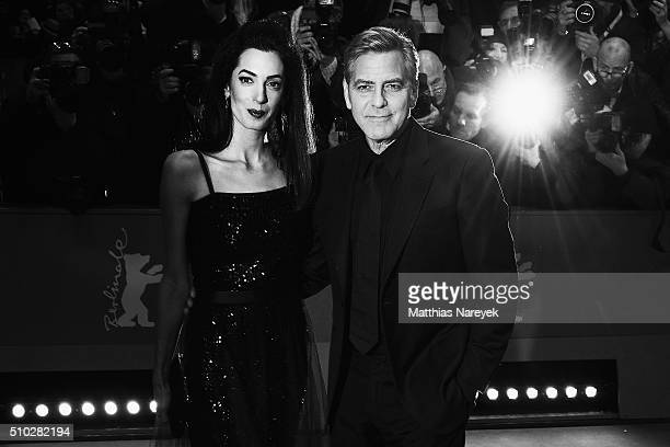 George Clooney and his wife Amal Clooney attend the 66th Berlinale International Film Festival on February 11 2016 in Berlin Germany