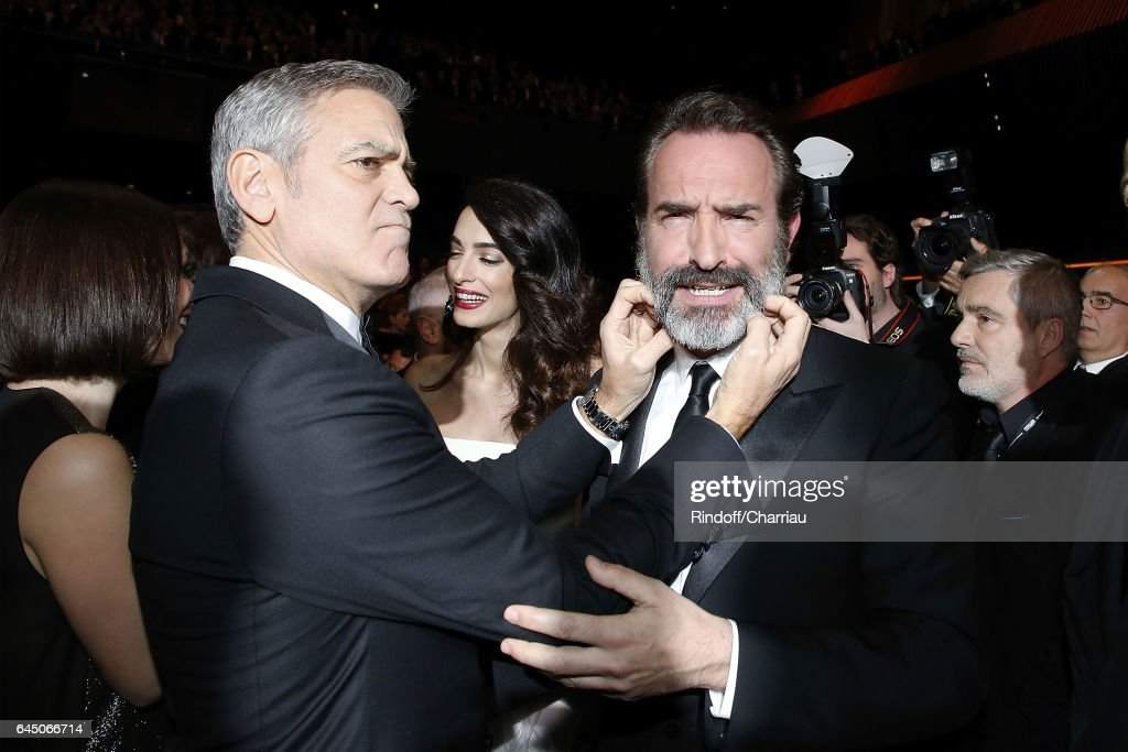 George Clooney and Jean Dujardin attend Cesar Film Award 2017 at Salle Pleyel on February 24, 2017 in Paris, France.