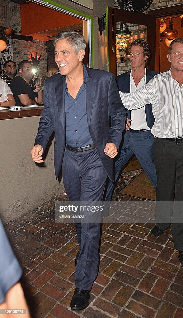 <a gi-track='captionPersonalityLinkClicked' href=/galleries/search?phrase=George+Clooney&family=editorial&specificpeople=202529 ng-click='$event.stopPropagation()'>George Clooney</a> and Rande Gerber sighting leaving Rocco's Tacos on January 8, 2013 in Fort Lauderdale, Florida.