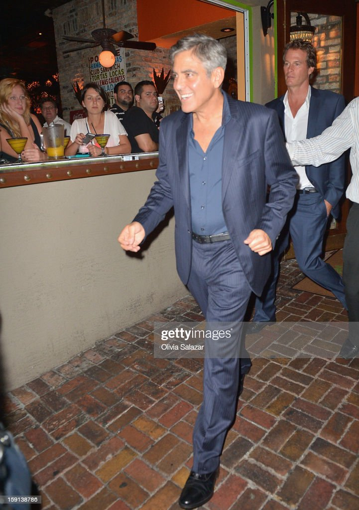 <a gi-track='captionPersonalityLinkClicked' href=/galleries/search?phrase=George+Clooney&family=editorial&specificpeople=202529 ng-click='$event.stopPropagation()'>George Clooney</a> and <a gi-track='captionPersonalityLinkClicked' href=/galleries/search?phrase=Rande+Gerber&family=editorial&specificpeople=549565 ng-click='$event.stopPropagation()'>Rande Gerber</a> sighting leaving Rocco's Tacos on January 8, 2013 in Fort Lauderdale, Florida.