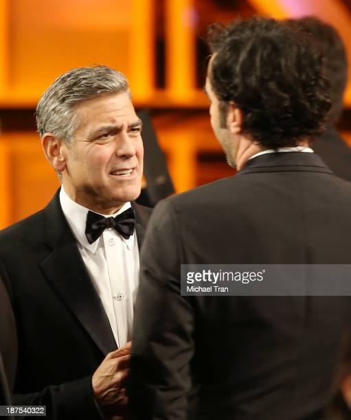 George Clooney and Sacha Baron Cohen attend onstage during the BAFTA Los Angeles Britannia Awards held at The Beverly Hilton Hotel on November 9 2013...