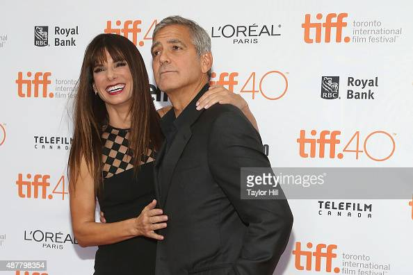 George Clooney and Sandra Bullock attend the premiere of 'Our Brand is Crisis' at the Princess of Wales Theatre during the 2015 Toronto International...
