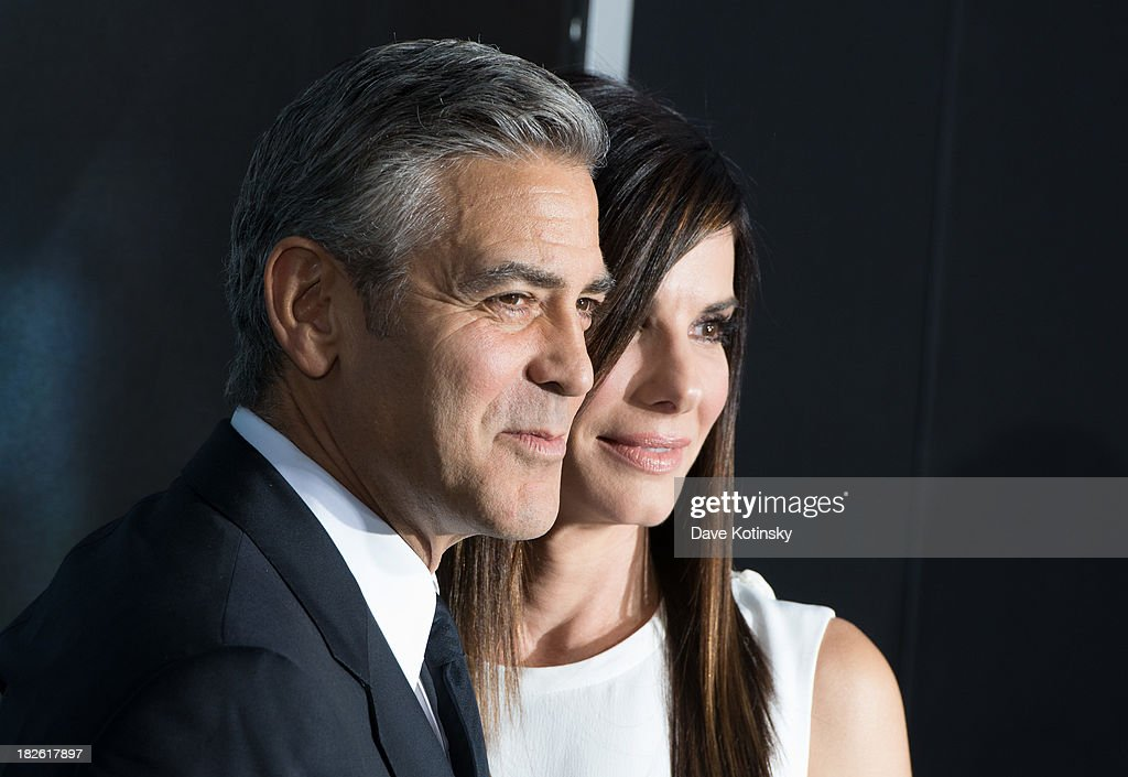 <a gi-track='captionPersonalityLinkClicked' href=/galleries/search?phrase=George+Clooney&family=editorial&specificpeople=202529 ng-click='$event.stopPropagation()'>George Clooney</a> and <a gi-track='captionPersonalityLinkClicked' href=/galleries/search?phrase=Sandra+Bullock&family=editorial&specificpeople=202248 ng-click='$event.stopPropagation()'>Sandra Bullock</a> attends the 'Gravity' premiere at AMC Lincoln Square Theater on October 1, 2013 in New York City.