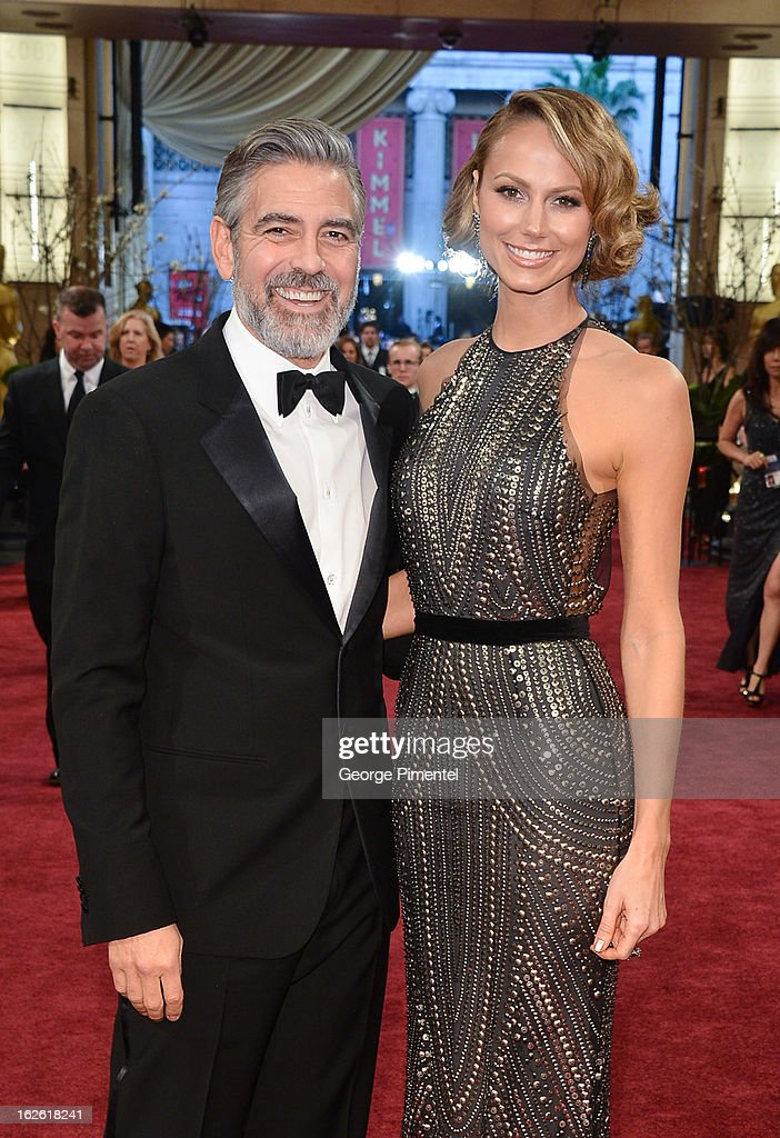 George Clooney and Stacy Keibler arrive at the Oscars at Hollywood & Highland Center on February 24, 2013 in Hollywood, California. at Hollywood & Highland Center on February 24, 2013 in Hollywood, California.