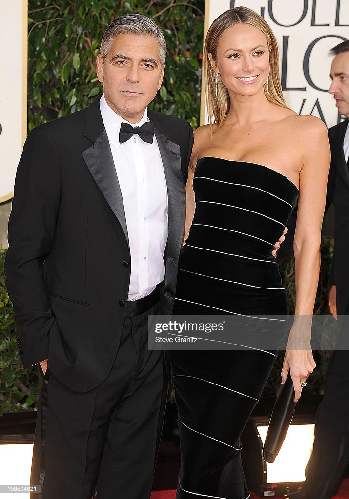George Clooney and Stacy Keibler arrives at the 70th Annual Golden Globe Awards at The Beverly Hilton Hotel on January 13, 2013 in Beverly Hills, California.