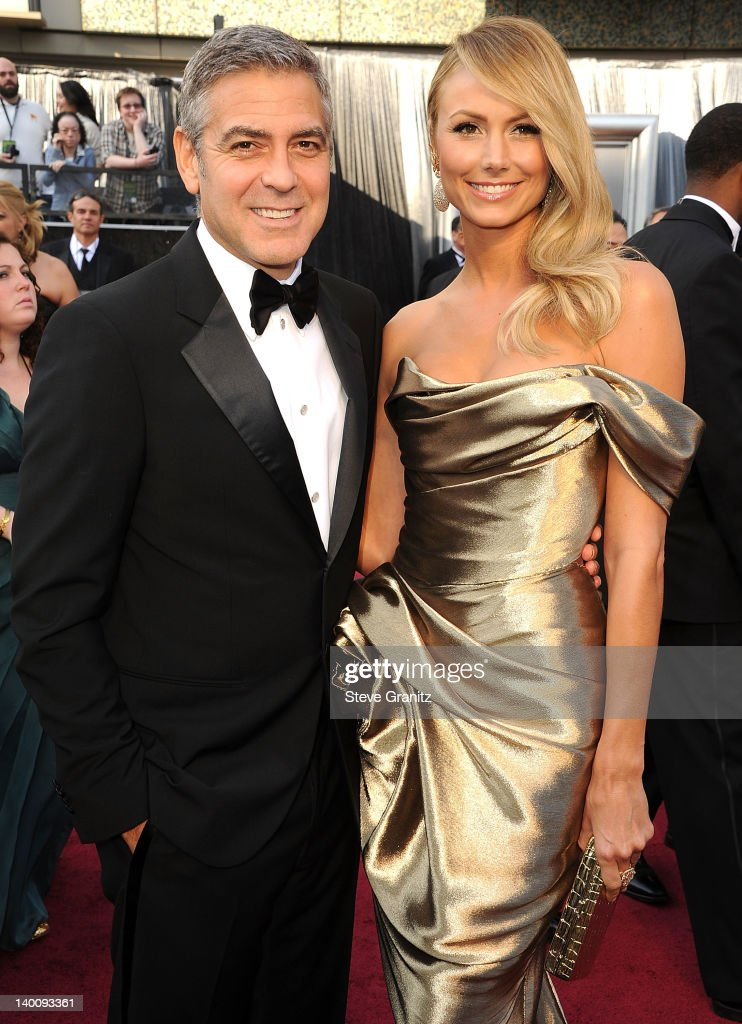 <a gi-track='captionPersonalityLinkClicked' href=/galleries/search?phrase=George+Clooney&family=editorial&specificpeople=202529 ng-click='$event.stopPropagation()'>George Clooney</a> and <a gi-track='captionPersonalityLinkClicked' href=/galleries/search?phrase=Stacy+Keibler&family=editorial&specificpeople=3031844 ng-click='$event.stopPropagation()'>Stacy Keibler</a> arrives at the 84th Annual Academy Awards at Grauman's Chinese Theatre on February 26, 2012 in Hollywood, California.